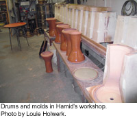 Drums and molds in Hamid's workshop.  Photo by Louie Holwerk.