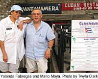 "Yolanda Fabregas and Mario Moya in front of their restaurant ""Guantanamera.""  Photo by Twyla Clark."