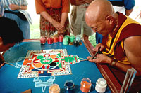The Venerable Ngawang Chojor making a sand mandala. Photo by Andy Kraushaar.
