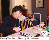 Kwong Yem Han painting in her home.  Photo by Nicole saylor.