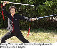 Yem Han practicing with two double-edged swords.