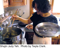 Judy Yeh cooking tsung tzu dumplings.  Photo by Twyla Clark.